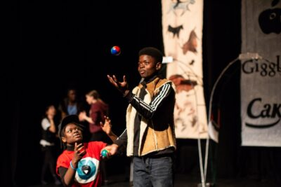 A young performer juggling
