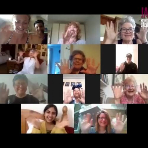 A large group of people talk on a Zoom meeting