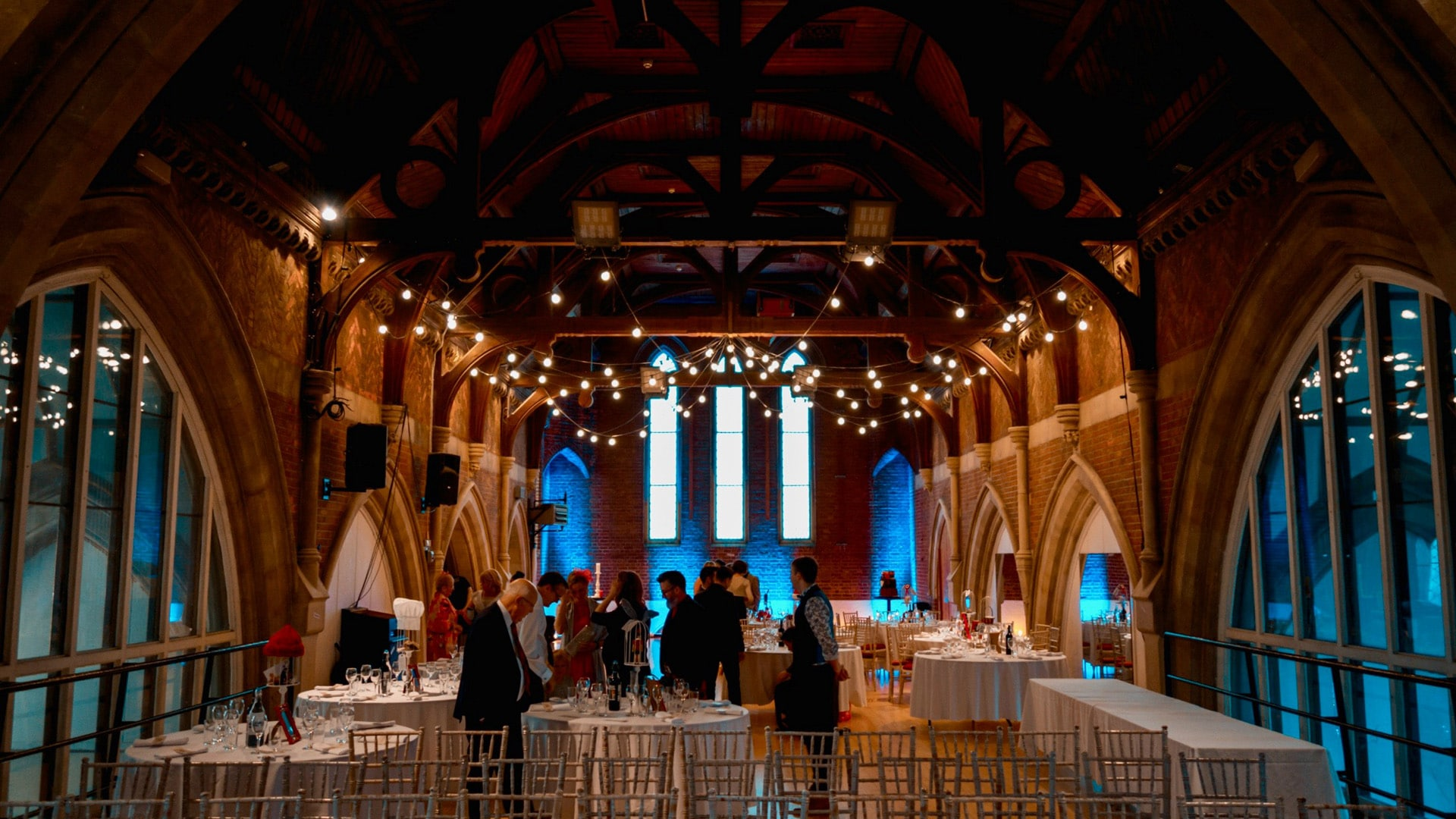 Wedding preparations take place at Jacksons Lane - lights hang from the ceiling and people set up chairs and tables