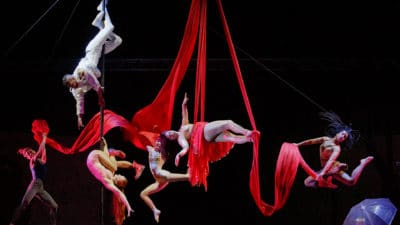 Performers doing acrobatic dancing on stage