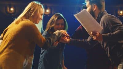 Three actors hand-stack