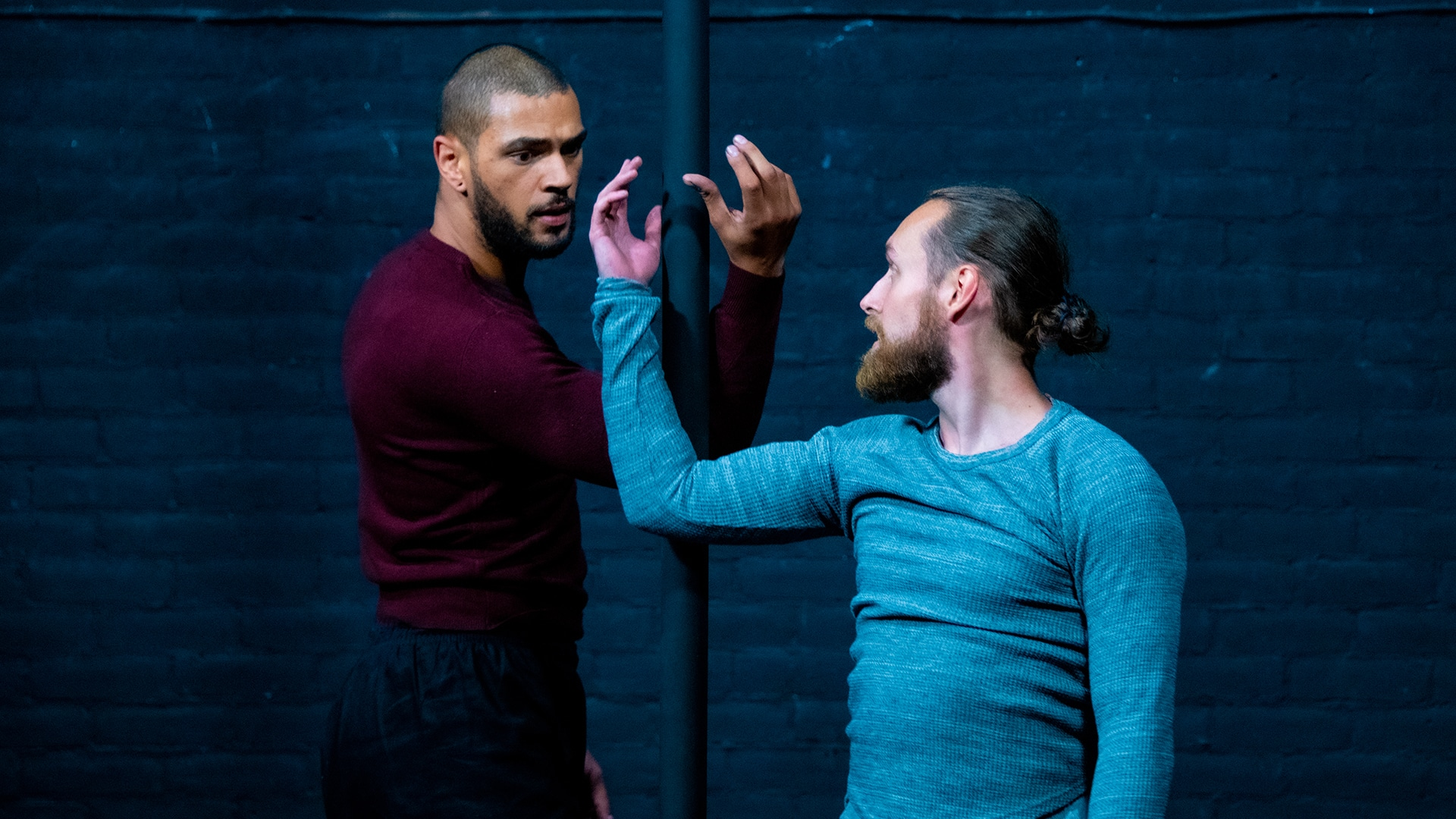 Sadiq Ali and Hauk Pattison stare at one another their arms bent and almost entwined
